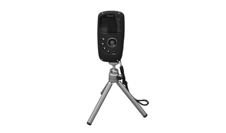 This is an image of a Kodak Playsport video camera on a tripod.